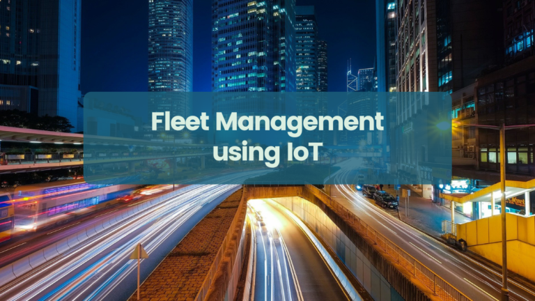 City lights in the background, banner reading Fleet Management Using IoT in the foreground