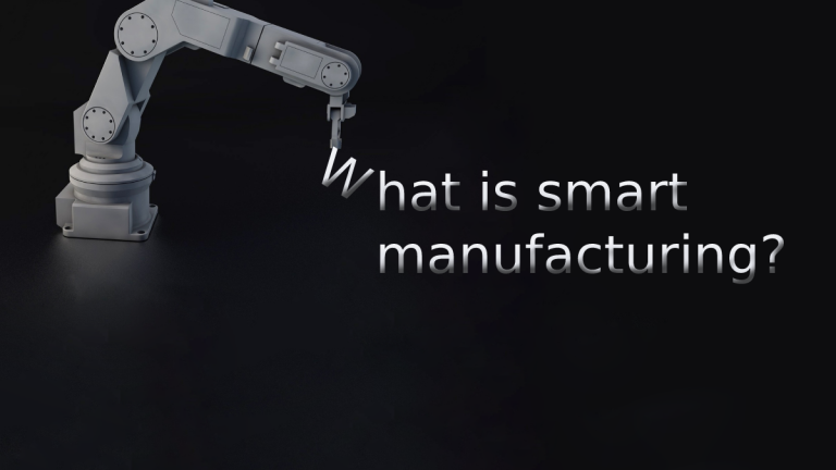 """A robotic arm appears to be assembling a block of text that says """"What is smart manufacturing?"""""""